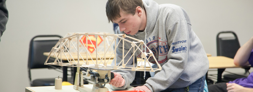 Student working on bridge in class