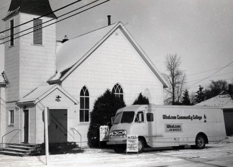 Bookmobile in front of the United Methodist Church in Custer, corner of Bruce Rd. and Main St., circa 1973
