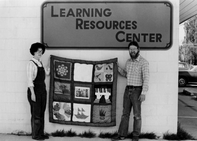 Library staff Laura McKenzie and Jim Dodd at the Learning Resources Center on Marine Drive