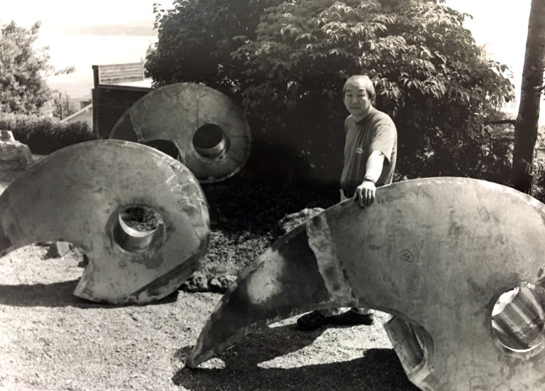 "Sculptor Gerard Tsutakawa during fabrication of his piece, ""The Gathering"""