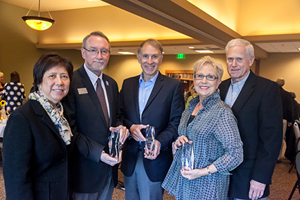 Donor Appreciation Honorees pose President Kathi Hiyane-Brown and their awards